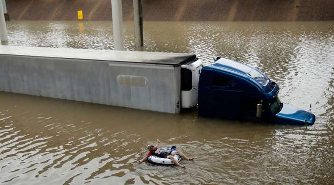 truck immersed in floodwaters