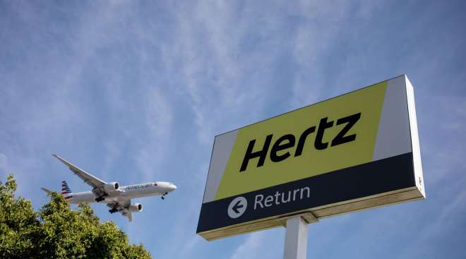 Signage is displayed outside of a Hertz rental location at Los Angeles International Airport (LAX) in Los Angeles in August 2019.