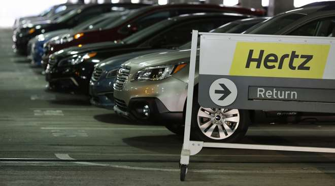 Vehicles at a Hertz rental location at the airport in Charlotte, N.C.