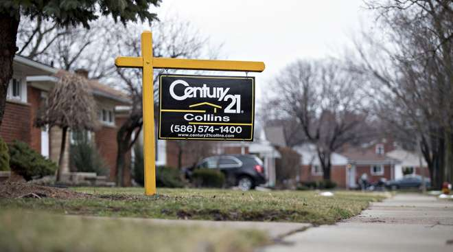 Century 21 Real Estate signage is displayed outside a home for sale in St. Clair Shores, Mich.