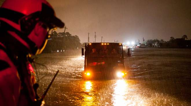 Texas Guardsmen from the 272nd Engineer Battalion partnered with Texas Task Force One, prepare to help evacuate Texans in need during Hurricane Harvey in Houston.