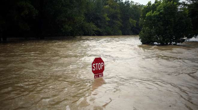 "A ""Stop"" sign stands in floodwaters due to Hurricane Harvey in Spring, Texas, U.S., on Monday, Aug. 28, 2017.;"
