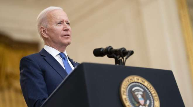 President Joe Biden speaks during an event in the White House on March 8. (Kevin Dietsch/Bloomberg News)