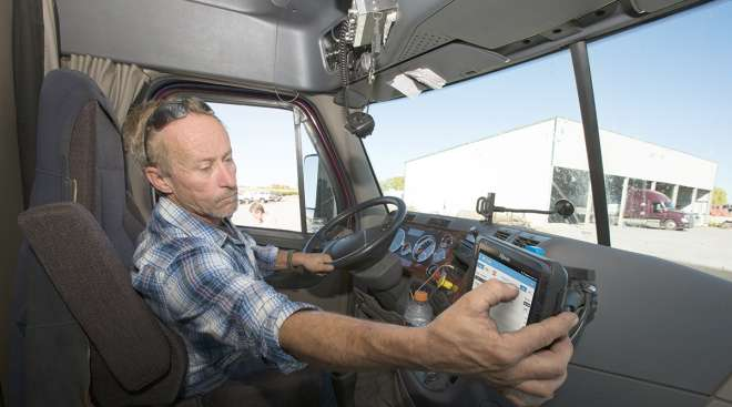 Driver checking his ELD