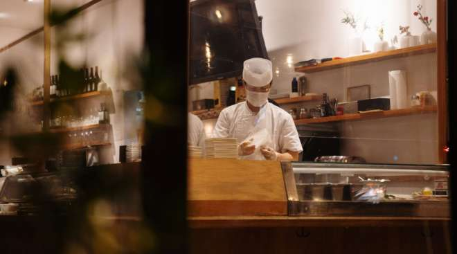 A sushi chef works inside a restaurant in Los Angeles. (Bing Guan/Bloomberg News)