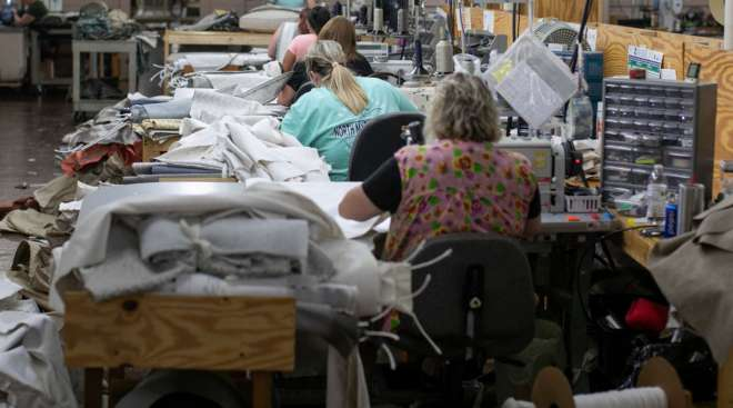 Employees sew fabric at a facility in Hickory, N.C. (Logan Cyrus/Bloomberg News)