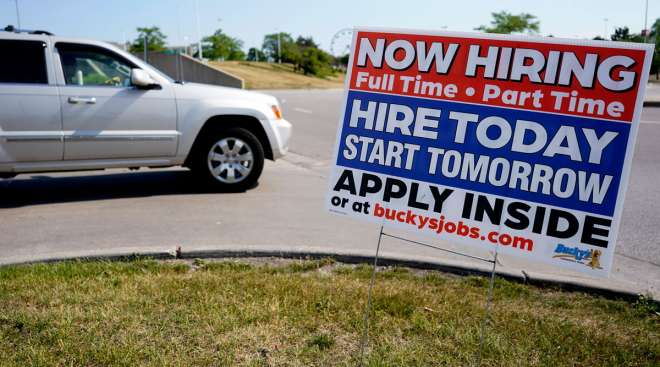 A hiring sign is displayed in Vernon Hills, Ill., on June 11. (Nam Y. Huh/Associated Press)