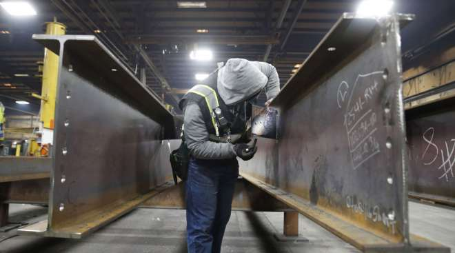 A worker inspects structural beams at a facility in Utah. (George Frey/Bloomberg News)
