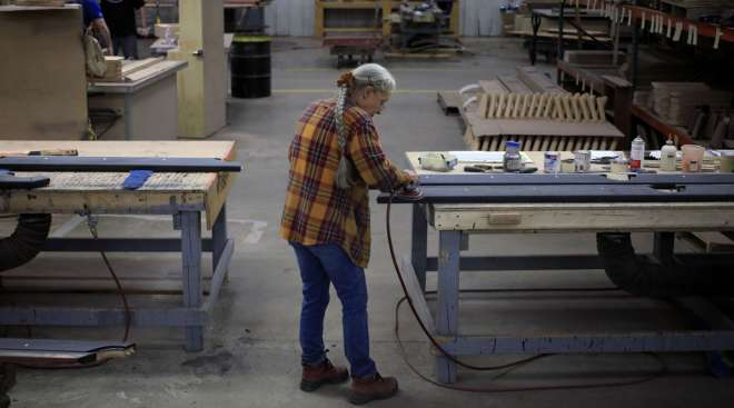 A worker sands wood components for a pool table in Jeffersonville, Ind. (Luke Sharrett/Bloomberg News)