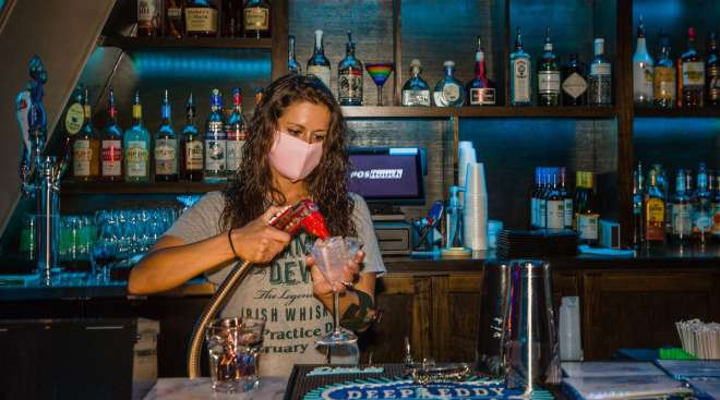 A bartender makes a drink at a nightclub in Columbia, S.C.