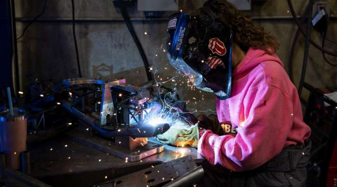 A worker welds bumpers at a facility in Eugene, Ore. (Alisha Jucevic/Bloomberg News)