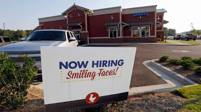 A help wanted sign at a new Zaxby's restaurant in Madison, Miss.