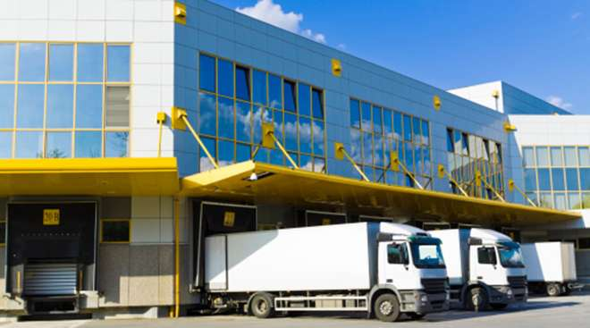 Loading dock with trucks and blue sky