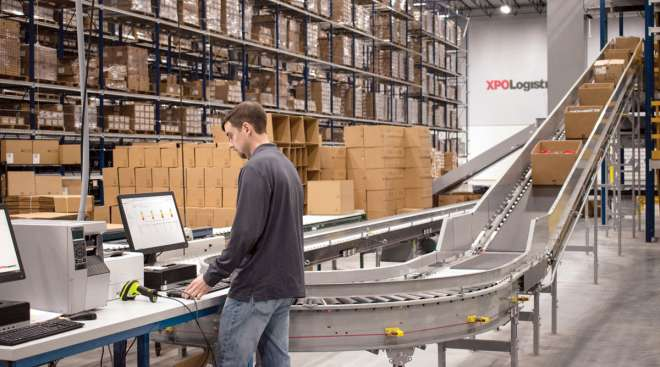An XPO Logistics employee works in a warehouse. (XPO Logistics)