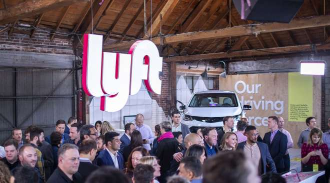 Signage is displayed during the Lyft IPO at the company's service center in Los Angeles in March 2019.
