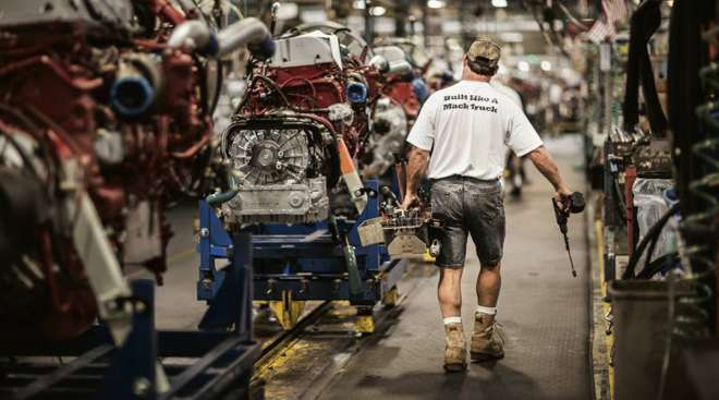 Worker at a Mack plant