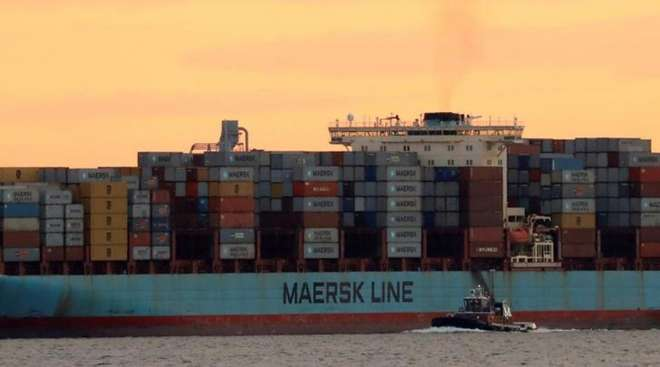 A Maersk containership at sunset