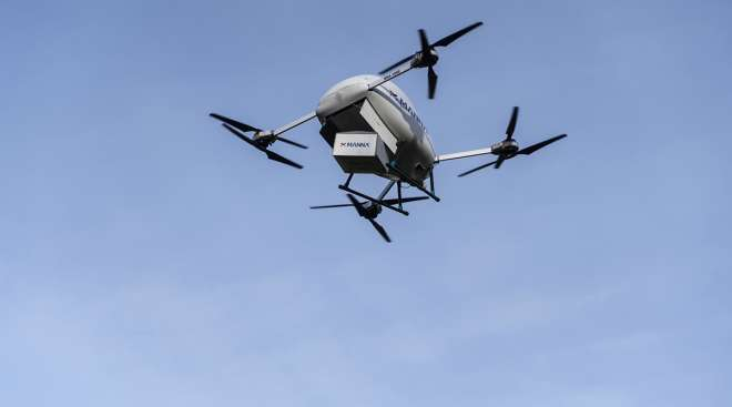 A Manna Aero drone delivers a parcel during a flight demonstration in Dublin, Ireland
