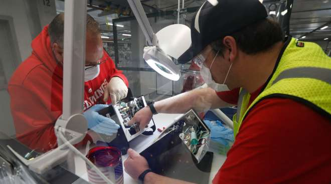 Ford employees work on a ventilator at a plant in Michigan on May 13.