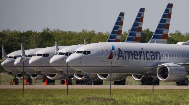 American Airlines Boeing 737 Max planes sit parked outside a hangar in Tulsa, Okla., in May 2019.