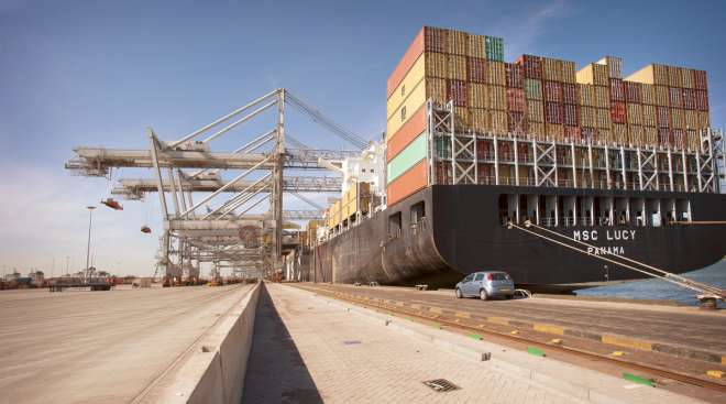 A massive containership docks at the Port of Rotterdam, the largest seaport in Europe