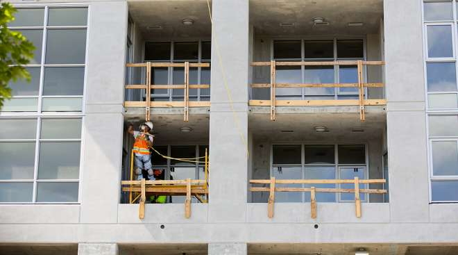 A contractor works during construction of a new apartment building in downtown Seattle.