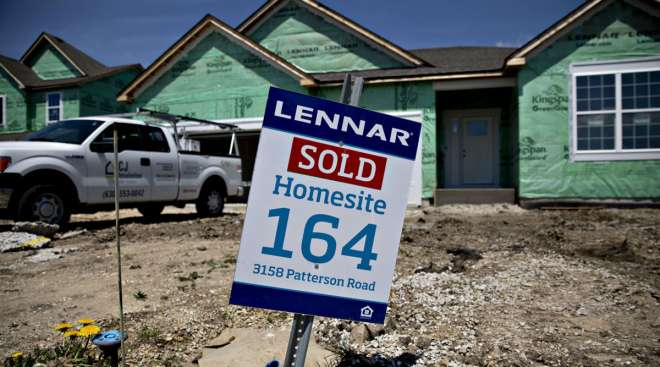 """A """"Sold"""" sign is displayed outside a home under construction in Illinois."""