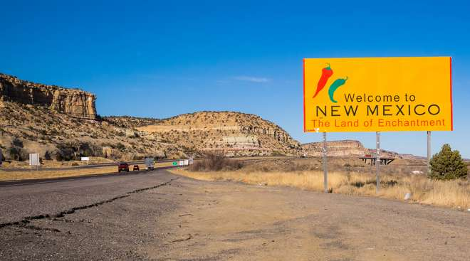 Welcome to New Mexico sign near a highway