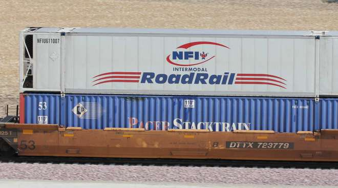 NFI intermodal containers travel by rail