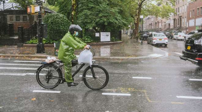 A delivery rider during tropical storm Henri in Brooklyn