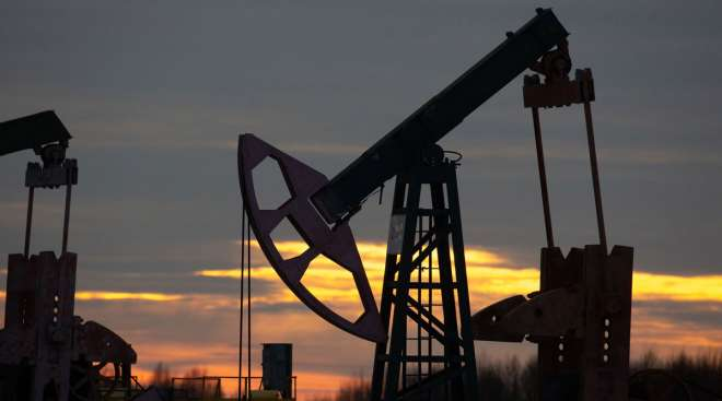 An oil pumping jack operates in an oilfield in Russia in November 2020.