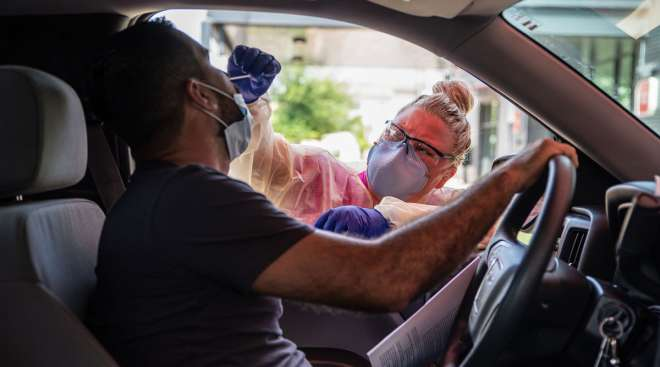 A driver gets tested for coronavirus at a testing center in Austin, Texas, on July 7.