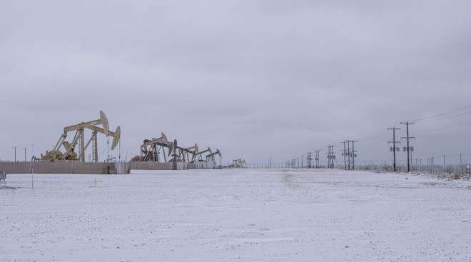 Pump jacks operate in the Permian Basin in Midland, Texas, on Feb. 13. (Matthew Busch/Bloomberg News)