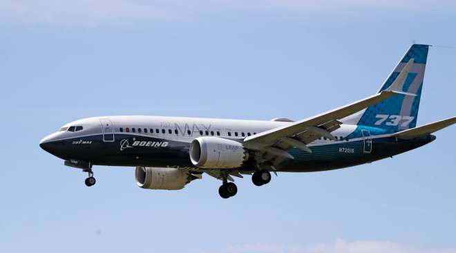 A Boeing 737 Max jet heads to a landing following a test flight in Seattle on June 29.