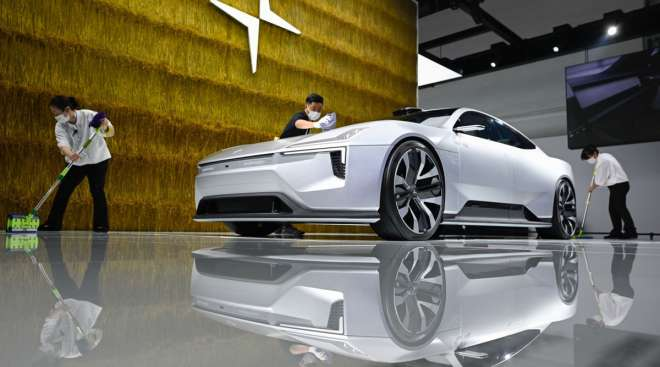Polestar staff cleans a concept car at the Beijing Auto Show. (Wang Zhao/AFP/Getty Images)
