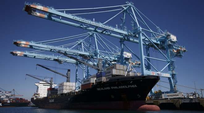 Cranes unload Maersk containers at the Port of Los Angeles