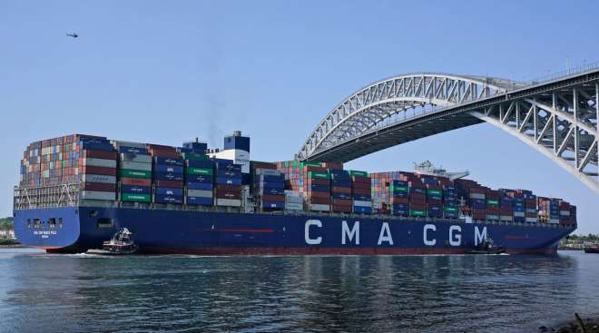The CMA CGM Marco Polo passes underneath the Bayonne Bridge in New Jersey on May 20. (Seth Wenig/Associated Press)