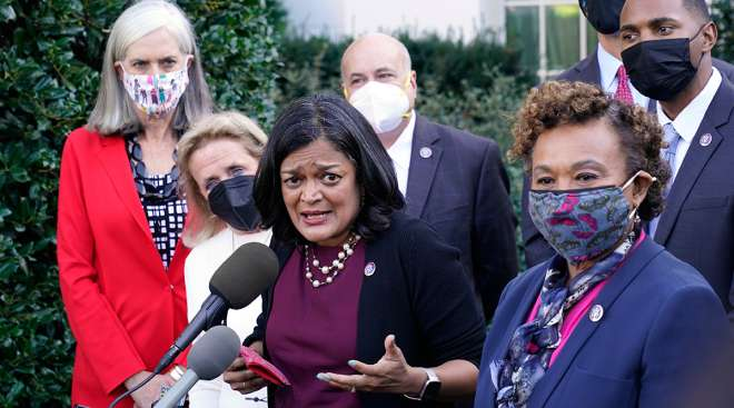 Rep. Pramila Jayapal (D-Wash.), the chair of the Congressional Progressive Caucus, surrounded by other lawmakers.