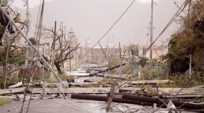 Smashed poles and snarled power lines brought down by Hurricane Maria in Puerto Rico