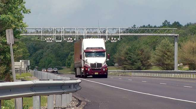 Truck passes under Rhode Island toll gantry