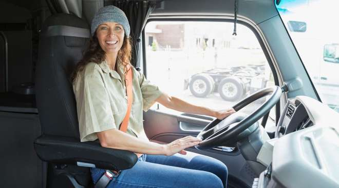 Female truck driver wearing a seat belt