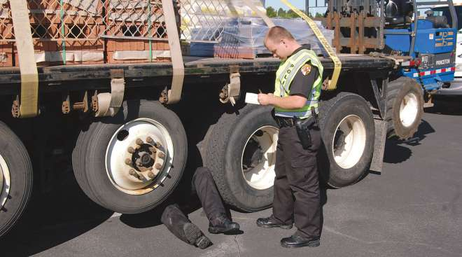 Inspectors checking a truck