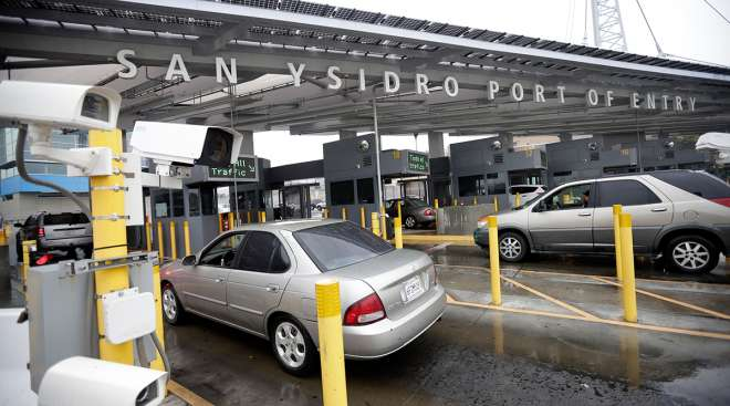 Cars wait to enter the United States from Tijuana, Mexico through the San Ysidro port of entry in San Diego.