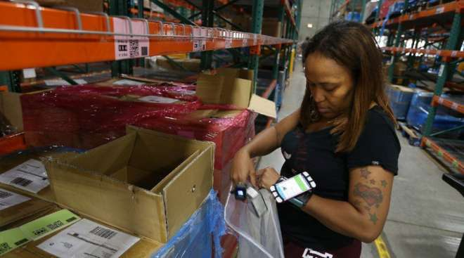 Syrina Franklin, an order fulfillment associate at ShipBob, picks products for an order.