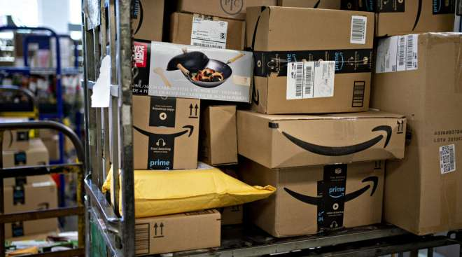 Amazon boxes sit at a USPS facility in Fairfax, Va., in May. (Andrew Harrer/Bloomberg News)