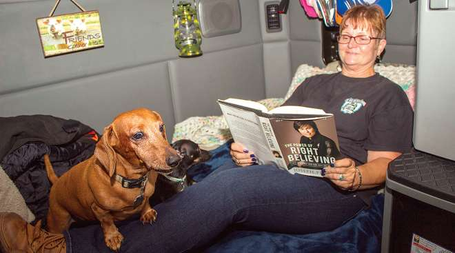 Driver and her dogs in a sleeper berth