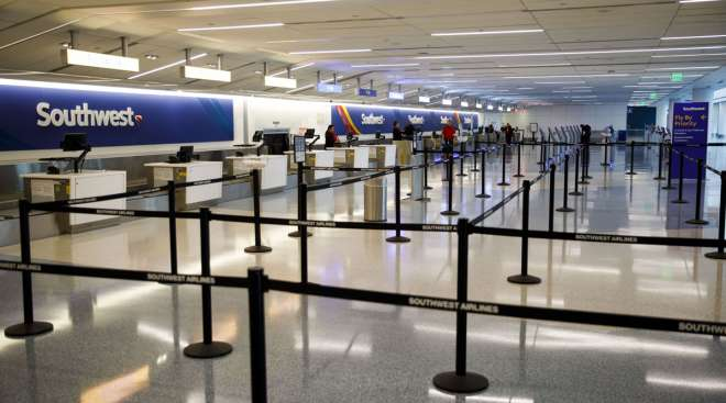 A Southwest Airlines check-in area at a nearly empty terminal in LAX.