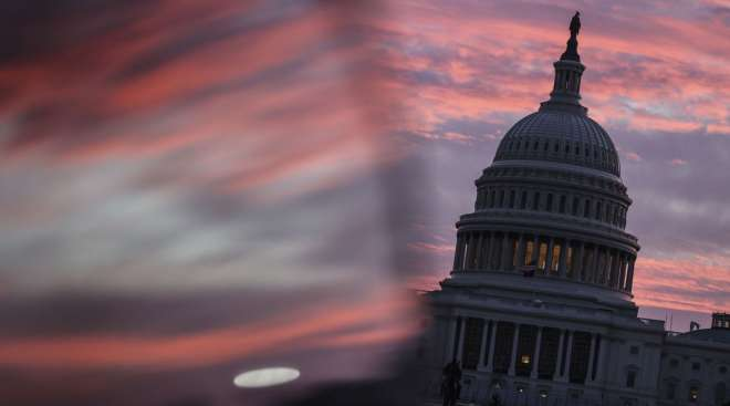 The U.S. Capitol is seen at dawn on Dec. 28. (Oliver Contreras/Bloomberg News)
