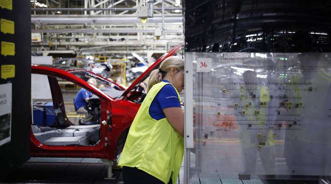 A worker views an implementation map at a Toyota Motor Corp. manufacturing plant
