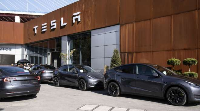 Tesla Model Y electric vehicles sit outside the automaker's showroom in Shanghai, China, in January.